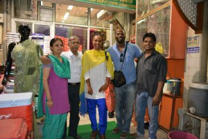 Outside of the sari shop with Mr. & Mrs. Lall